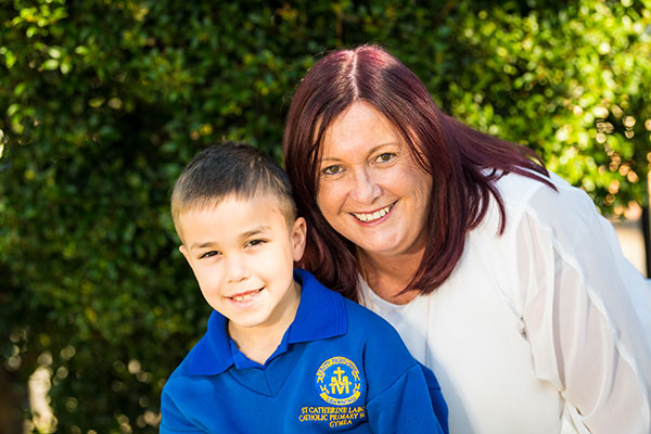 Principal of St Catherine Laboure Catholic Primary School Gymea smiling with student