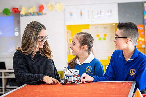 Teacher and students working with robotics at St Catherine Laboure Catholic Primary School Gymea