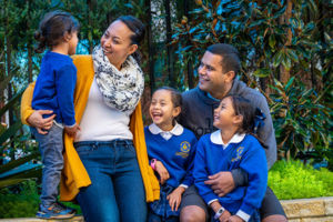 Family smiling and talking at St Catherine Laboure Catholic Primary School Gymea