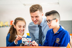 Teacher and students working with robotics at St Catherine Labouré Catholic Primary School Gymea