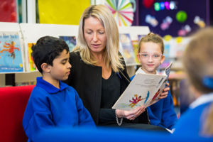 Teacher reading to students at St Catherine Labouré Catholic Primary School Gymea