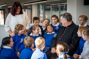 Parosh Priest and Principal of St Catherine Laboure Catholic Primary School Gymea chatting with students