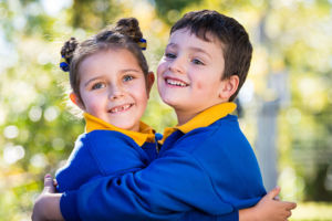 St Catherine Labouré Catholic Primary School Gymea students hugging